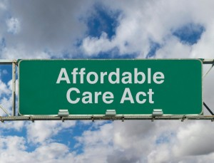 Picture of freeway sign  with phrase Affordable Care Act