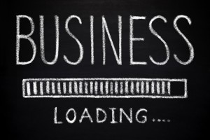 Picture of blackboard with phrase business loading written out