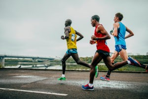 Picture of Omsk, Russia - September 20, 2015: three leaders of the marathon running along the embankment of the Irtysh river during Siberian international marathon