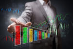 Picture of Businessman pointing to a growth chart showing business success