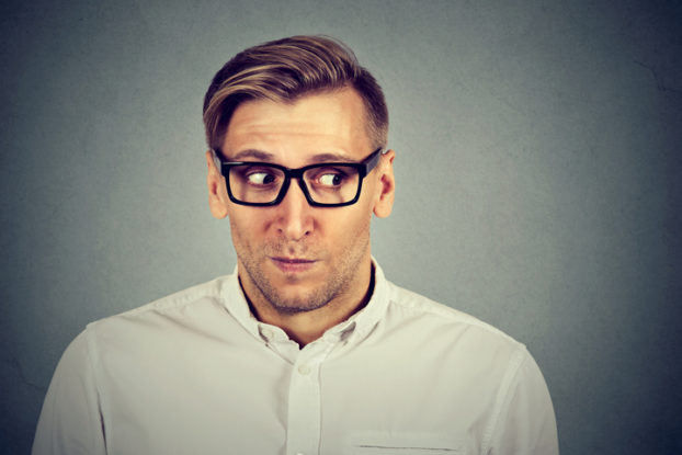 Picture of preoccupied man worried about why file out of state tax returns
