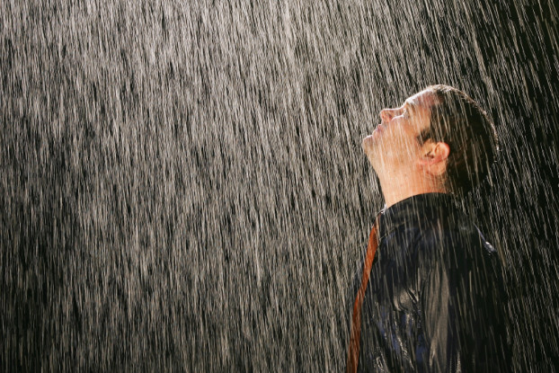 Picture of man standing in pouring rain