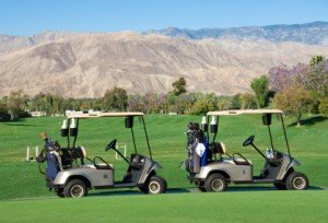 Picture of golf carts on course in desert.