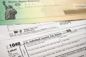 Picture of a tax refund check  on top of 1040 tax return.