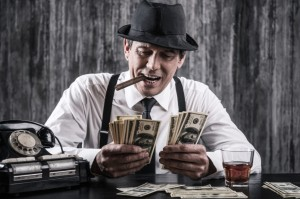 Picture of man smoking cigar and counting money.
