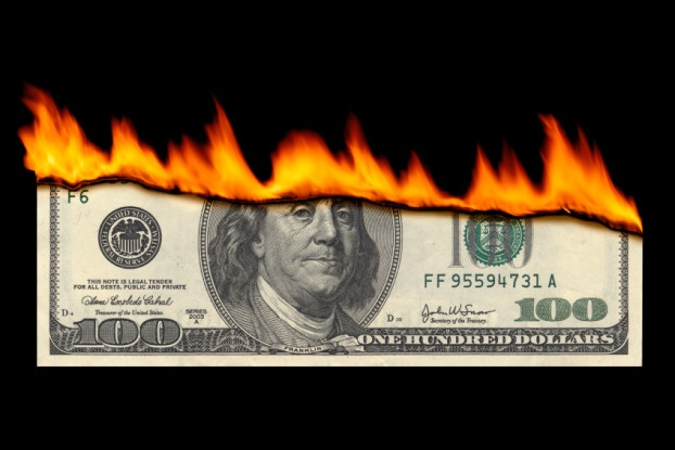 Picture of $100 bill on fire.