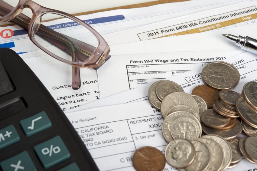 tax forms calculator coingage and reading glasses