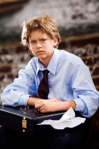 Picture of boy in dress shirt and tie holding briefcase
