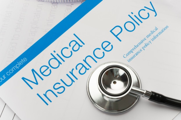 Picture of health insurance policy brochure with stethoscope