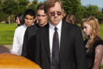 People at a graveside service