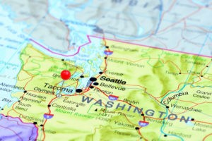 Photo of pinned Olympia on a map of USA. May be used as illustration for travelling theme.