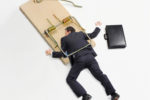 Picture of Businessman trapped on mousetrap