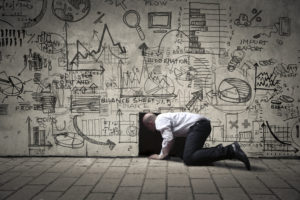 Picture of a man crawling into a small black hole, with illustrations on the wall.
