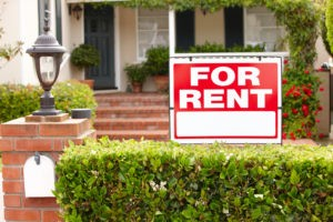 Picture of For Rent sign in front of rental house.