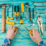 Picture of hand tools on a blue wooden table