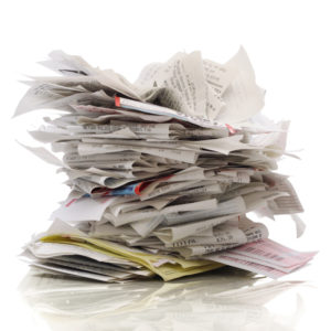 Picture of Huge stack of tax deduction receipts on a white background