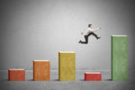 Picture of man jumping for blog post about modeling portfolio risk with cFIREsim and FIRECalc