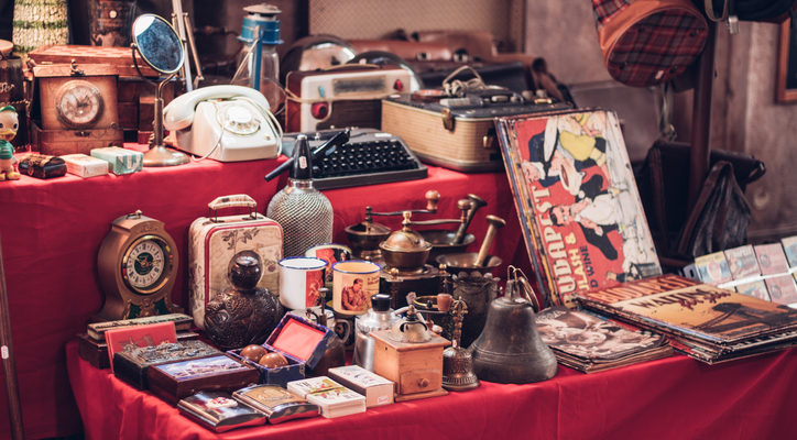A picture of antique watches, magazines, phones, suitcases and other retro products for a blog post about Section 199A trade or business