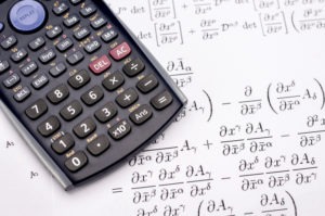 A picture of a Scientific calculator and mathematical equations for the calculus of growth
