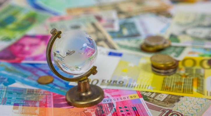 Picture for Section 951 GILTI tax blog post showing a tiny glass globe against background of currency